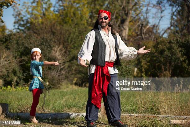 Father and daughter in pirate costumes
