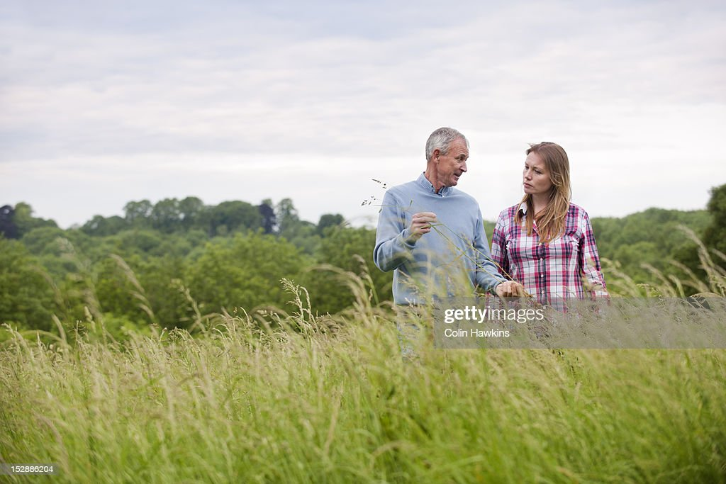 Father and daughter in tall grass : Stock Photo