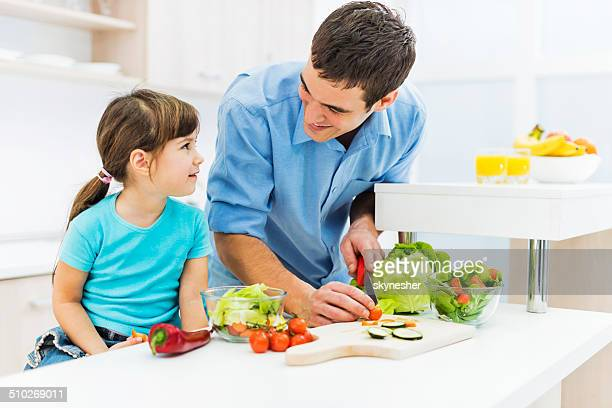 Father and daughter in the kitchen.