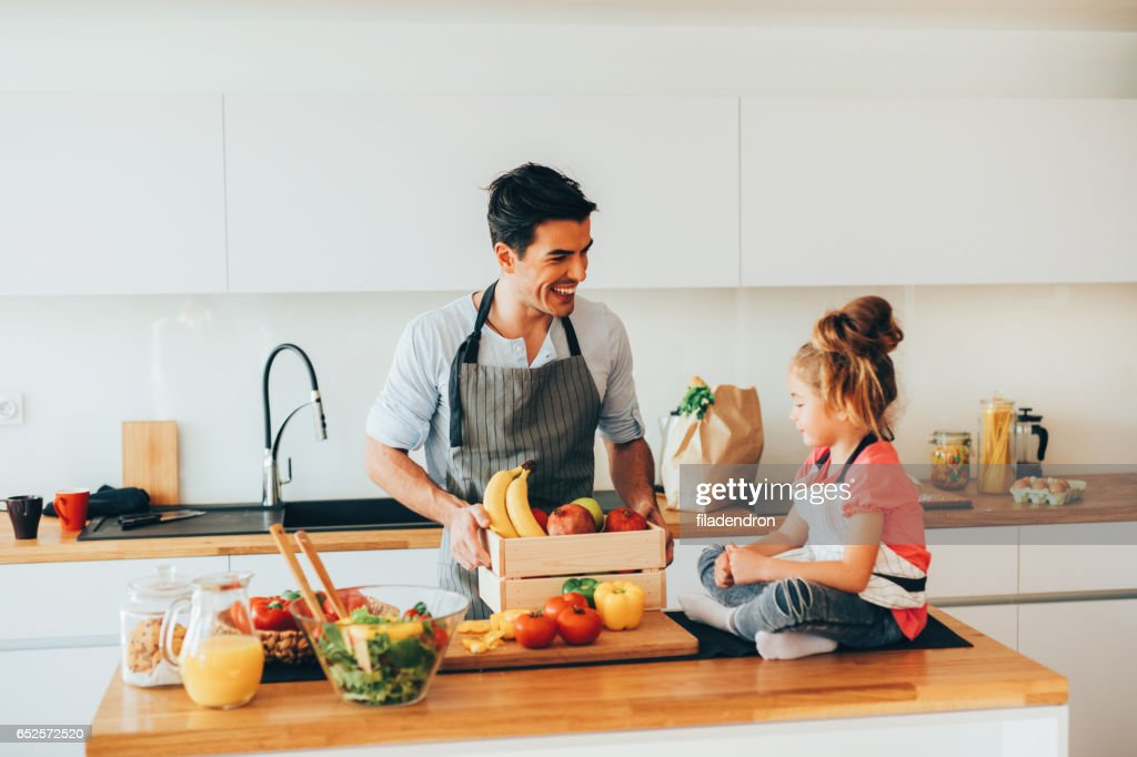 Father and daughter in the kitchen : Stock Photo