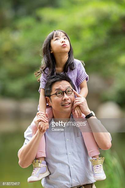 father and daughter in the park - cary stockfoto's en -beelden