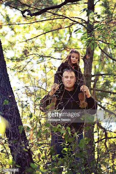 Father and daughter in woods