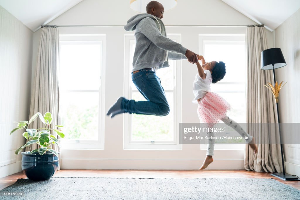 Father and daughter jumping while doing ballet : Stock Photo