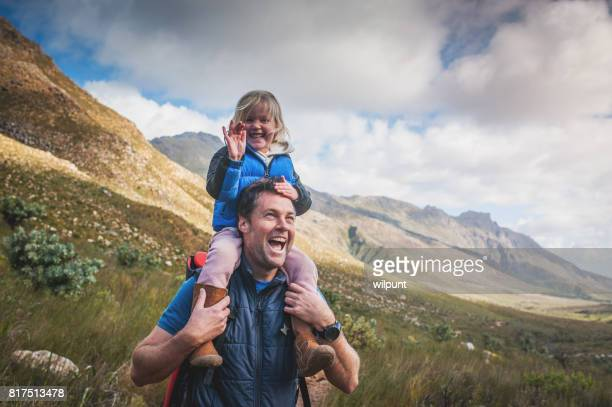 Father and Daughter Laughing with Delight in the Outdoors