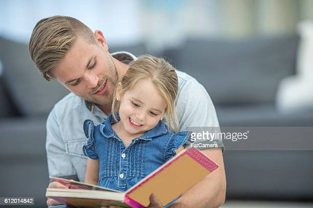 Father and Daughter Looking at a Book