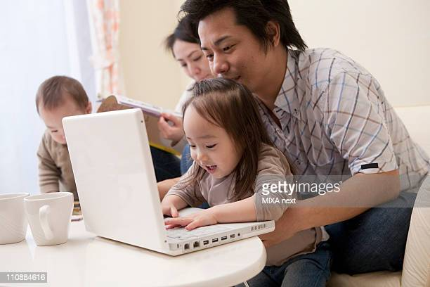 Father and Daughter Looking at PC