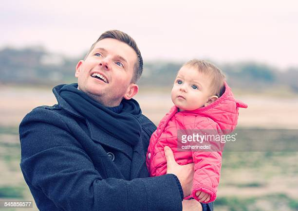 father and daughter (6-11 months) looking up - 6 11 months stock pictures, royalty-free photos & images