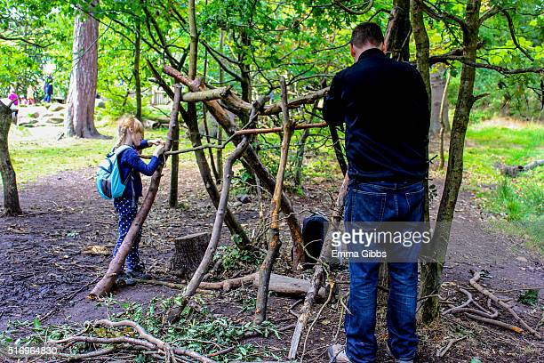 Father and Daughter making a den
