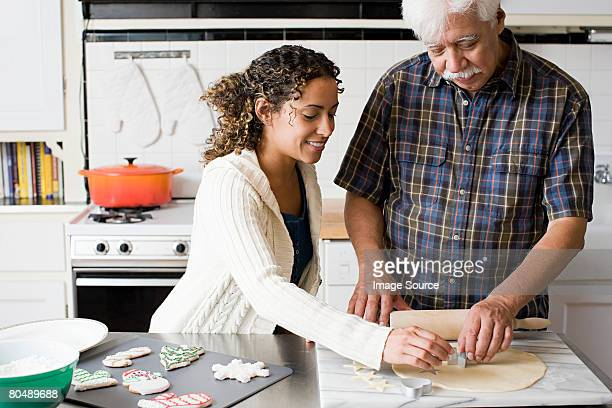 A father and daughter making cookies