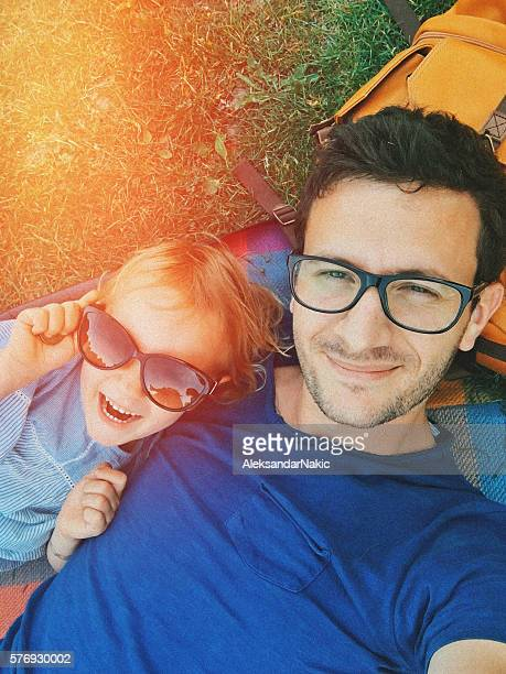 Father and daughter making selfi on a picnic