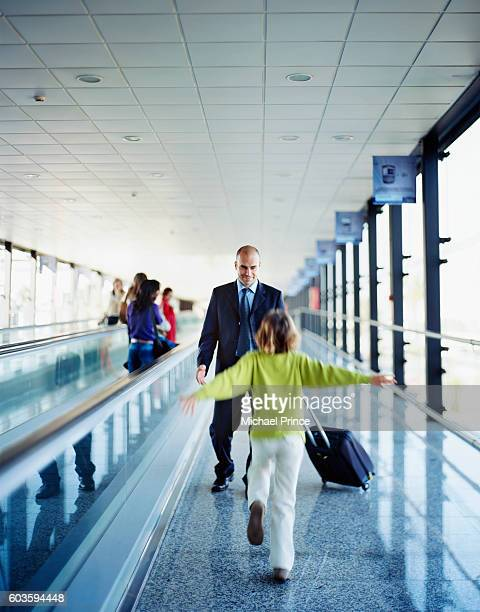 Father and Daughter Meeting in Airport