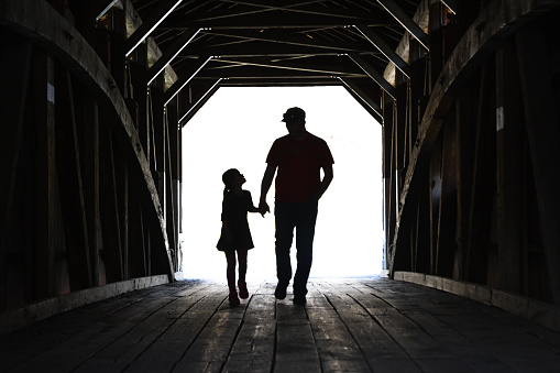 Father And Daughter On A Covered Bridge 475264152