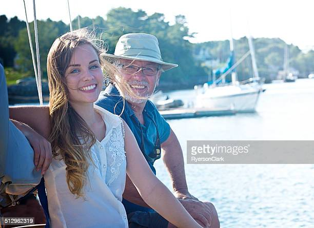 father and daughter on a sailboat, mahone bay  nova scotia - old man young woman stock photos and pictures