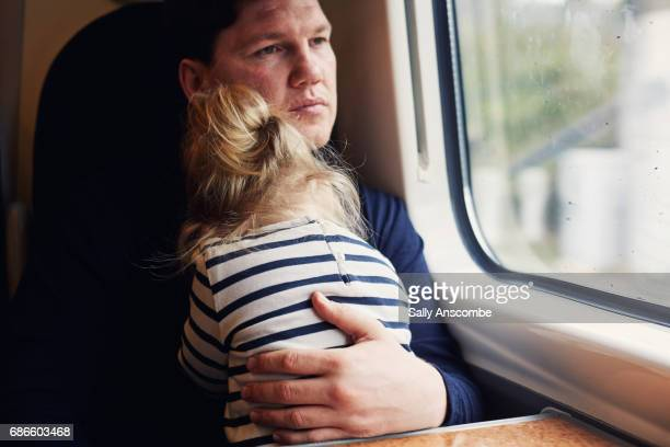 Father and daughter on a train