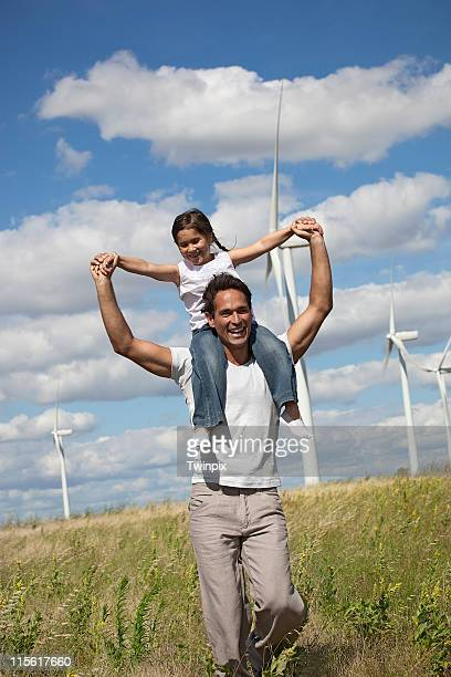 Father and daughter on a windfarm