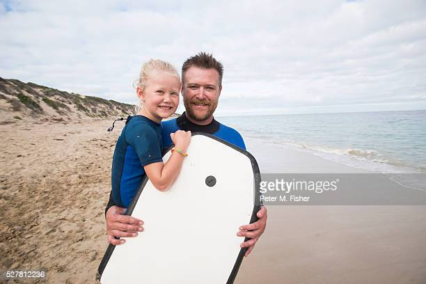 Father and daughter (4-5) on beach
