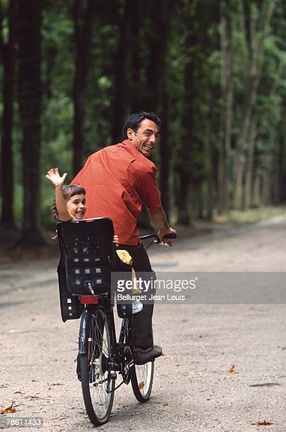 father and daughter on bicycle - luggage rack stock photos and pictures