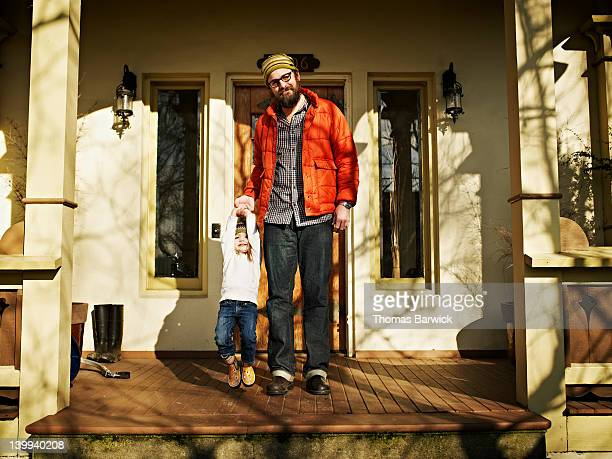 Father and daughter on front porch of home