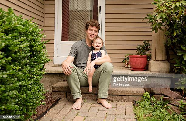 Father and daughter on front stoop