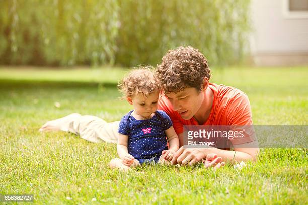 Father and daughter on lawn