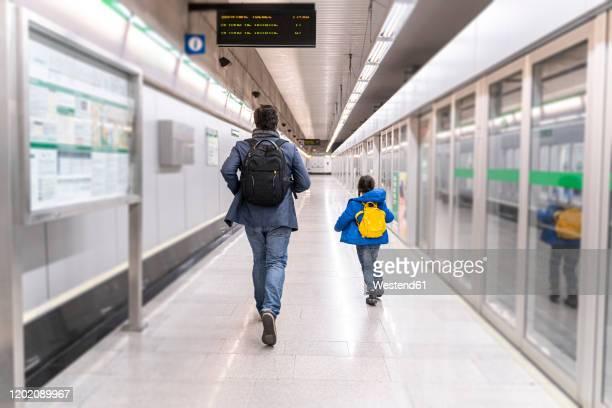 father and daughter on metro station, girl running away - förföljande bildbanksfoton och bilder