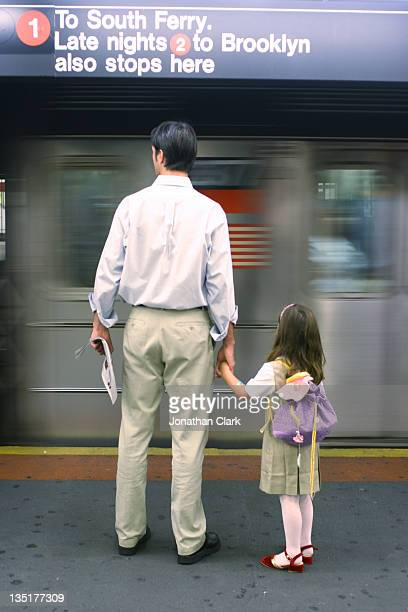 Father and daughter on New York subway
