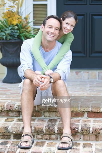 Father and Daughter on Porch