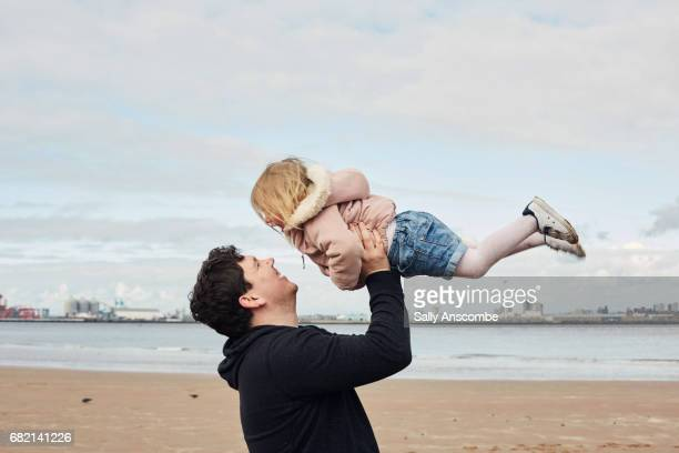 Father and daughter on the beach together