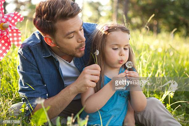 father and daughter outdoors in a meadow. - fathers day stock pictures, royalty-free photos & images