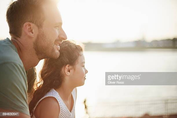father and daughter outdoors looking away - contemplation family stock pictures, royalty-free photos & images