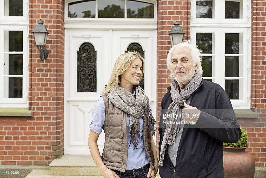 Father and daughter outside house : Stock Photo
