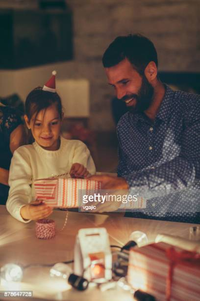 father and daughter packing christmas gifts - single father stock photos and pictures