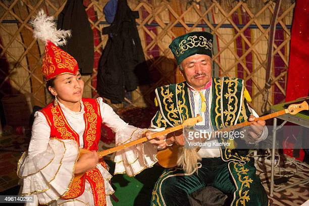 Father and daughter performing traditional Kazakh songs with Kazakh dombras in a ger near the city of Ulgii in the BayanUlgii Province in western...
