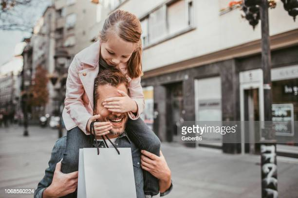 father and daughter - shopping stock pictures, royalty-free photos & images