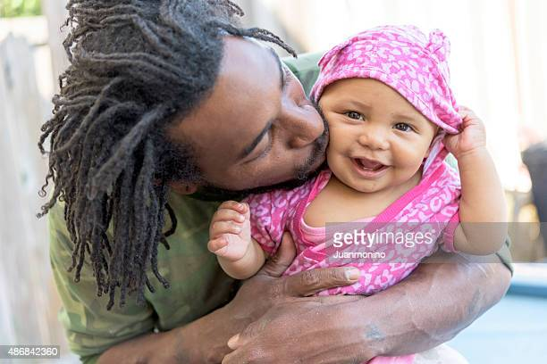 father and daughter - caribbean culture stock pictures, royalty-free photos & images