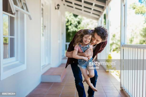 father and daughter - family home stock photos and pictures