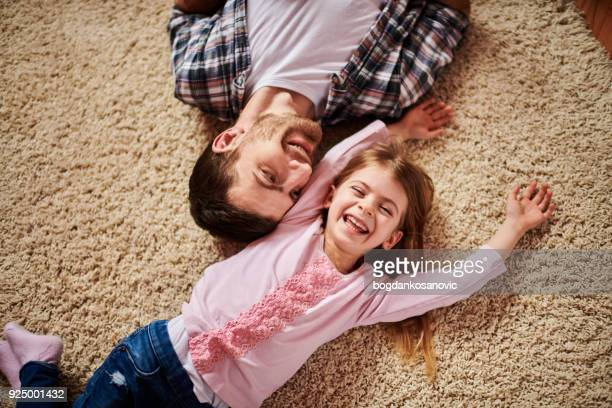 father and daughter - carpet stock photos and pictures