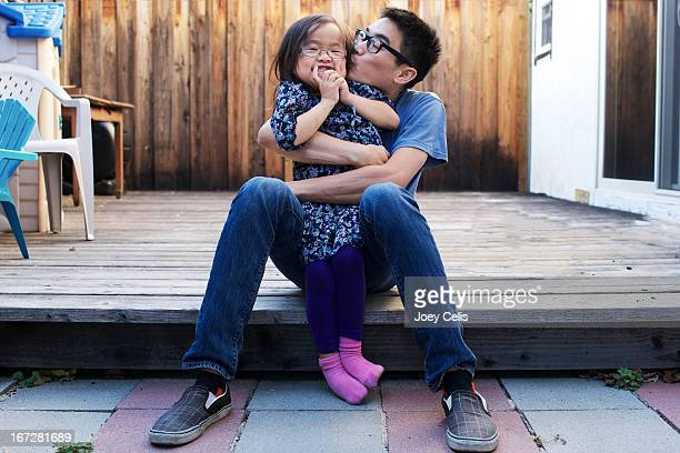 father and daughter playfully hug and kiss - indian girl kissing stock photos and pictures