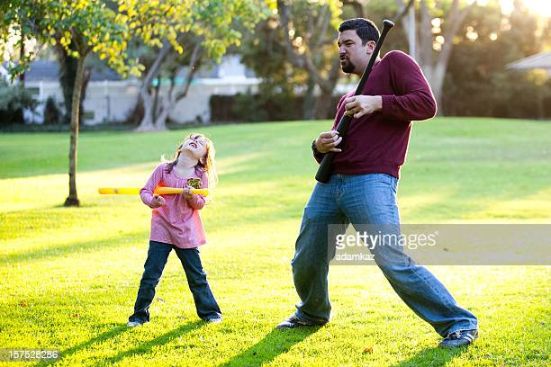 Father and Daughter playing Air Guitar