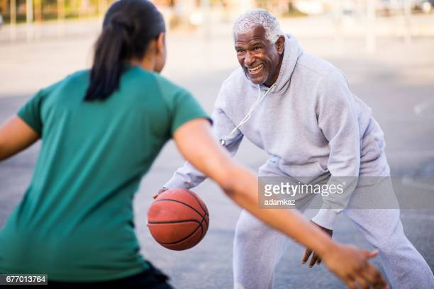 father and daughter playing basketball - american influence stock photos and pictures