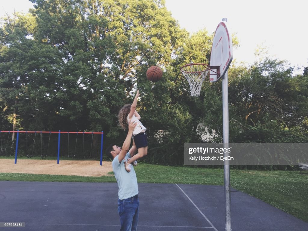 Father And Daughter Playing Basketball : Stock Photo
