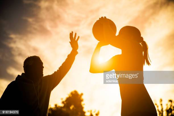 Father and Daughter Playing Basketball Silhouette