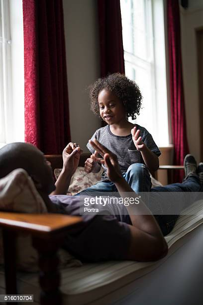 Father and daughter playing counting game at home