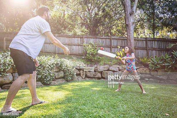 father and daughter playing cricket in the garden - cricket stockfoto's en -beelden