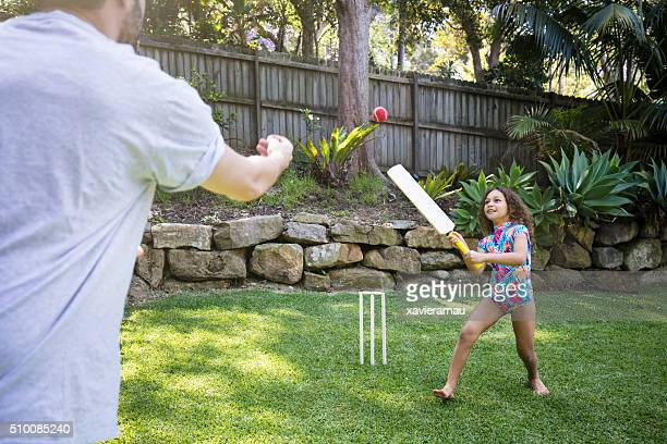 father and daughter playing cricket in the garden - sport of cricket stock pictures, royalty-free photos & images