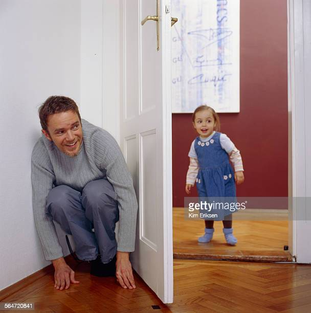 Father and Daughter Playing Hide-and-Seek
