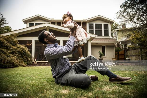 father and daughter (18 months) playing in backyard - lifestyle stock pictures, royalty-free photos & images