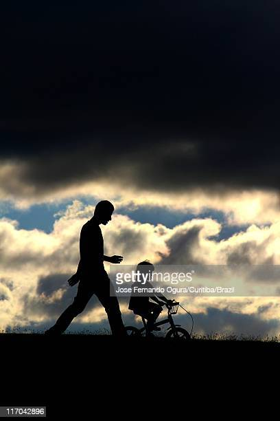 father and daughter playing in heaven - daughters of darkness stock pictures, royalty-free photos & images