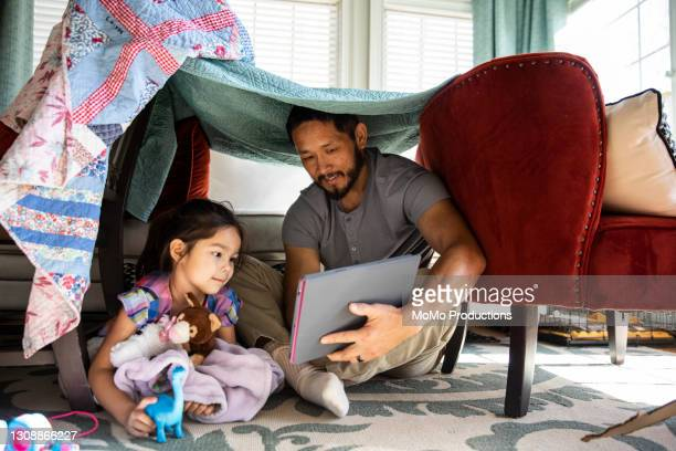 father and daughter playing in homemade fort - chairperson stock pictures, royalty-free photos & images
