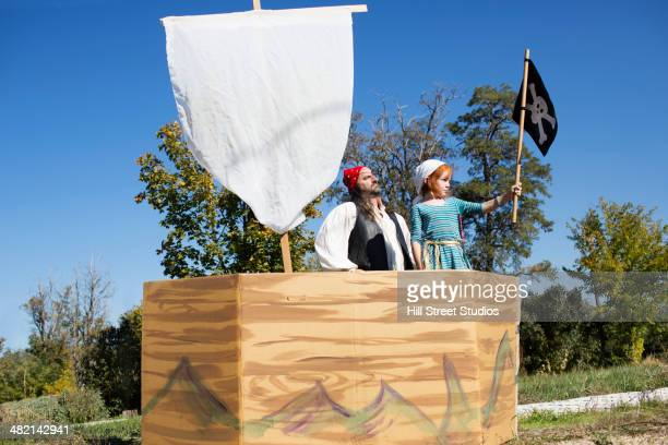 Father and daughter playing in pretend pirate ship